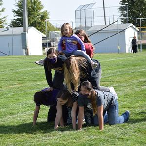 Students form a human pyramid