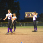 Girls softball players huddled on pitching mounc