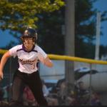 Softball playe stealing base