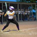 Girl hitting ball on field