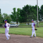 Boys baseball players in the field