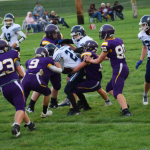 Football players in the middle of a play