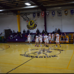 Boys basketball players shaking hands