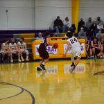 Boys basketball players playing defense