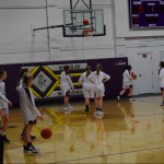 Girls basketball players warming up for the game