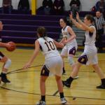 Girls basketball players playing defense