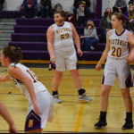 Girls basketball players in playing defense
