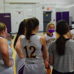 Girls basketball players in huddle