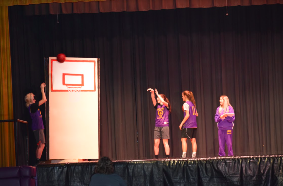 Spring Play students playing bb on stage