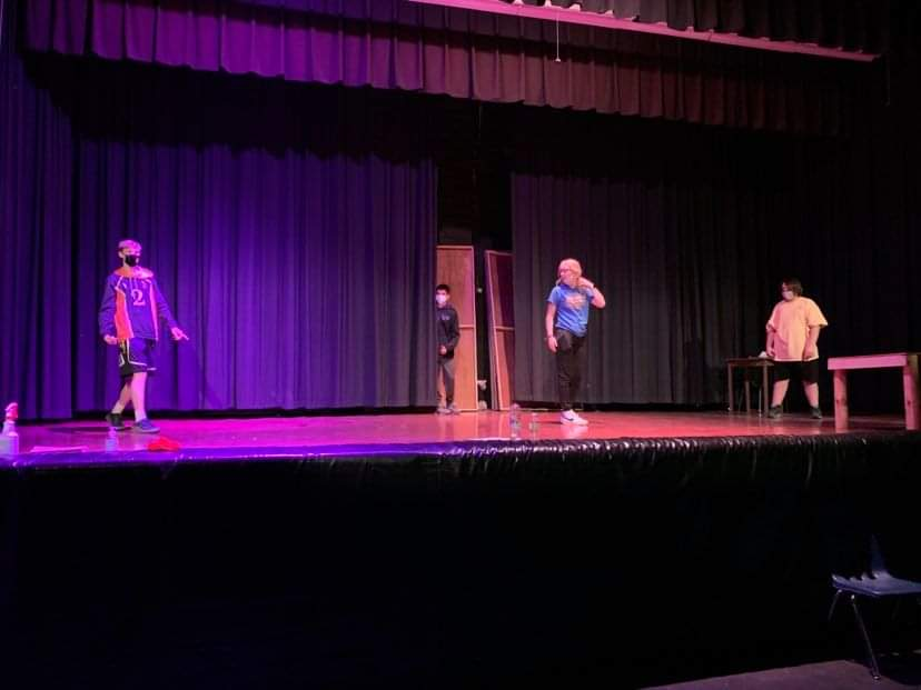 3 characters on stage during play