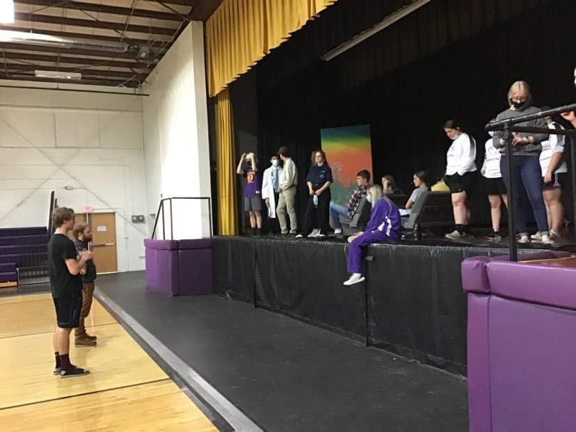 Cast standing on the stage