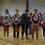 Homecoming court receiving gifts