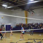 Girls HS Volleyball team playing volleyball