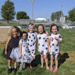 elementary twins dressed like dalmation dogs