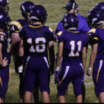 Team huddle on the field