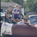 Homecoming king and queen candidates Calleigh and Wyatt in car